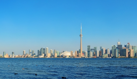 Toronto skyline panorama over lake with urban architecture