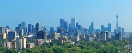 Toronto skyline panorama with urban architecture and blue sky photo