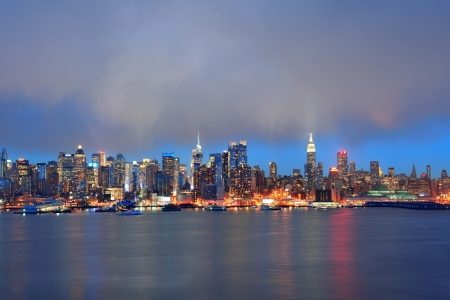 skyline at sunrise: New York City midtown Manhattan in the evening with skyline panorama view over Hudson River