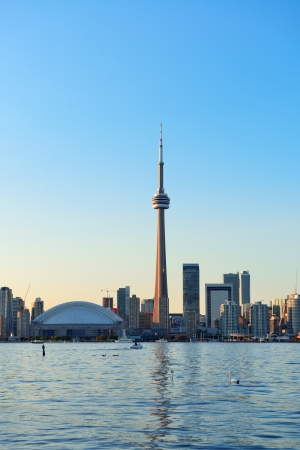Toronto skyline in the day over lake with urban architecture and blue sky Stock Photo - 20369679