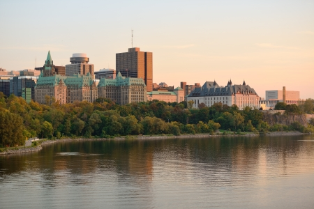 Ottawa sunset over river with historical architecture. photo