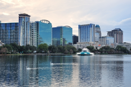 orlando: Orlando Lake Eola sunset with urban architecture skyline and colorful cloud Stock Photo