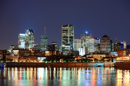 Montreal over river at dusk with city lights and urban buildings photo