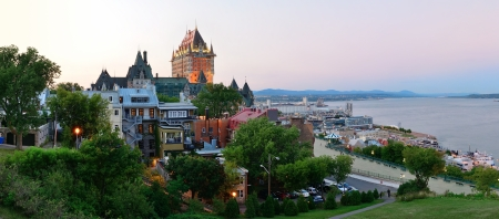 Quebec City skyline panorama with Chateau Frontenac at sunset viewed from hill photo