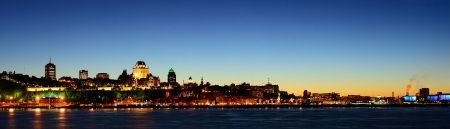 Quebec City skyline panorama at dusk over river viewed from Levis. photo