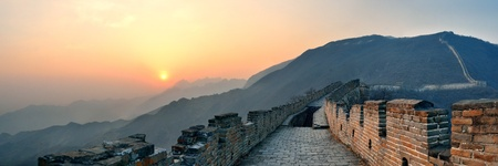 greatwall: Great Wall sunset panorama over mountains in Beijing, China. Stock Photo
