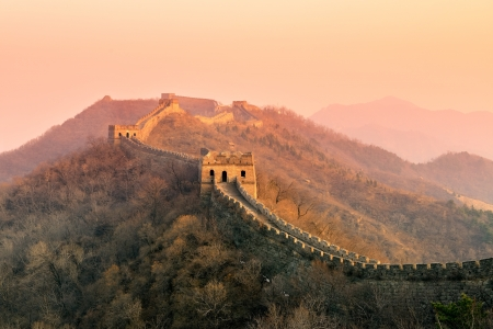 Great Wall sunset over mountains in Beijing, China. photo