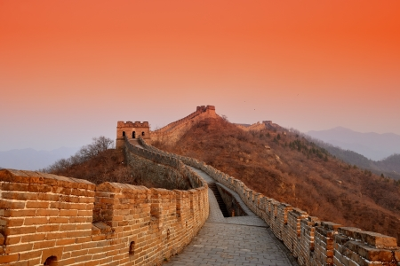 beijing: Great Wall sunset over mountains in Beijing, China.