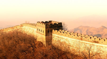 Shining Great Wall sunset over mountains in Beijing, China. photo