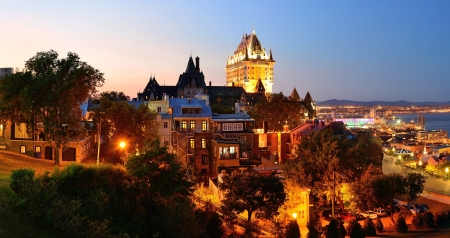 Quebec City skyline panorama with Chateau Frontenac at dusk viewed from hill photo