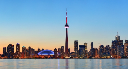 canada: Toronto sunset over lake panorama with urban skyline.
