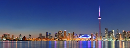 Toronto cityscape panorama at dusk over lake with colorful light. Stock Photo