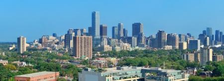 Toronto skyline panorama with urban architecture and blue sky photo