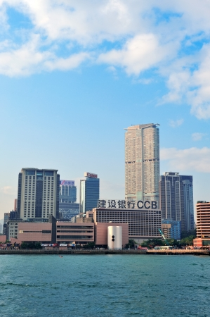 sq: HONG KONG, CHINA - APR 22: Crowded skyscrapers over sea on April 23, 2012 in Hong Kong, China. With 7M population and land mass of 1104 sq km, it is one of the most dense areas in the world.