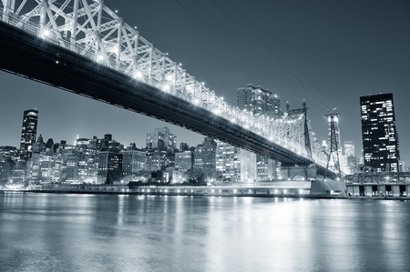 Queensboro Bridge over New York City East River black and white at night with river reflections and midtown Manhattan skyline illuminated.  Stock Photo - 20730393