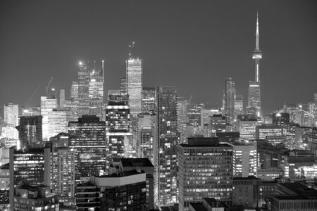 Toronto at dusk with city light and urban skyline with skyscrapers in black and white Stock Photo