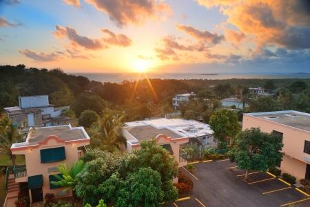 san juan: San Juan sunrise with colorful cloud, buildings and beach coastline.  Stock Photo