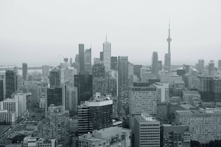 Toronto at dusk with city light and urban skyline with skyscrapers in black and white photo