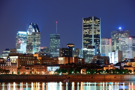 city lights: Montreal over river at dusk with city lights and urban buildings