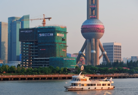excluding: SHANGHAI, CHINA - JUNE 2: Oriental Pearl Tower over river on JUNE 2, 2012 in Shanghai, China. The tower was the tallest structure in China excluding Taiwan from 1994~2007 and the landmark of Shanghai.
