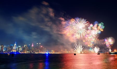 July 4th fireworks show of New York City with Manhattan midtown skyline over Hudson River. photo