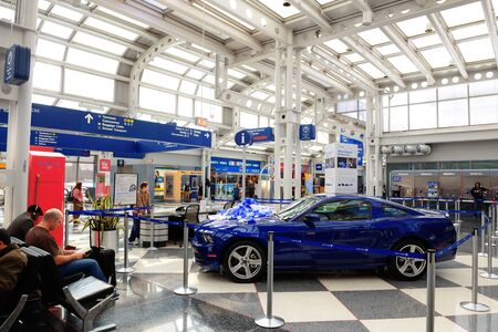 CHICAGO, IL - MAR 31: Chicago OHare Airport interior on March 31, 2013 in Chicago, Illinois. It is the worlds second busiest airport and was voted the Best Airport in North America for 10 years