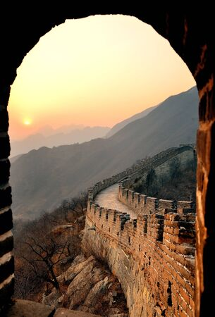 great wall: Great Wall sunset through window over mountains in Beijing, China.