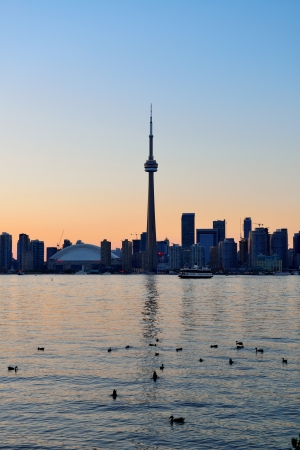 Toronto sunset silhouette at dusk over lake with urban architecture. Stock Photo - 21596362