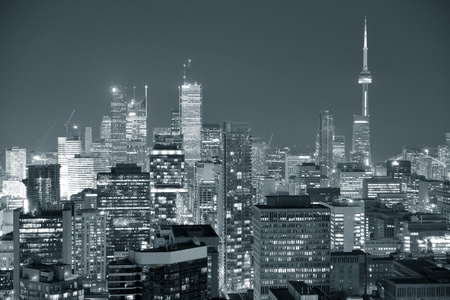 Toronto at dusk with city light and urban skyline with skyscrapers in black and white Stock Photo - 21604661