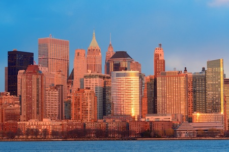 Downtown Manhattan skyline at sunset over Hudson River in New York City photo
