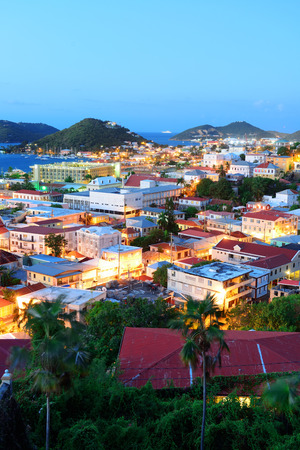 Virgin Islands St Thomas mountain view in early morning with buildings and beach coastline.  Stock Photo