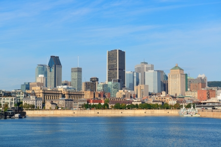 Montreal city skyline over river in the day with urban buildings photo