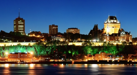 levis: Quebec City skyline at dusk over river viewed from Levis.