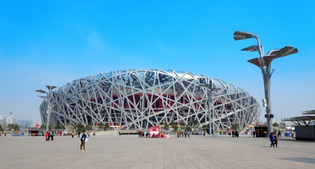 established: BEIJING, CHINA - APR 7: Beijing National Stadium with blue sky on April 7, 2013 in Beijing, China. The stadium was established for the 2008 Summer Olympics and Paralympics. Editorial