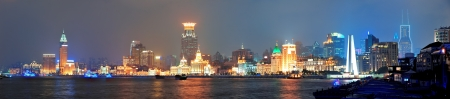 panoramic business: Shanghai urban architecture over river at dusk panorama