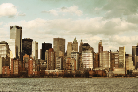 Downtown Manhattan skyline in old yellow tone over Hudson River in New York City