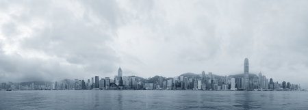 Hong Kong skyline in the morning over Victoria Harbour in black and white. photo