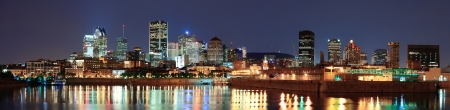 montreal: Montreal over river panorama at dusk with city lights and urban buildings Stock Photo