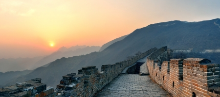 Great Wall sunset panorama over mountains in Beijing, China  photo