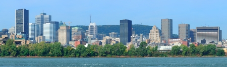Montreal city skyline panorama over river in the day with urban buildings Stock Photo