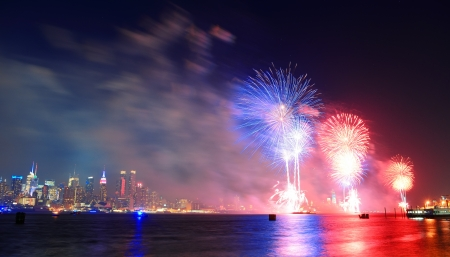 July 4th fireworks show of New York City with Manhattan midtown skyline over Hudson River  photo