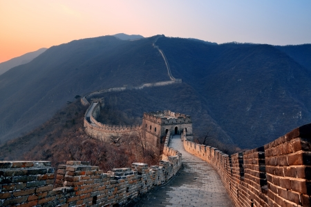 Great: Great Wall sunset over mountains in Beijing, China.
