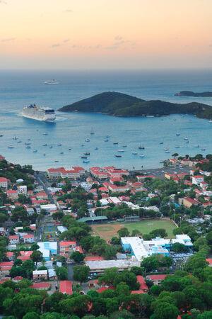 the virgin islands: Virgin Islands St Thomas sunrise with colorful cloud, buildings and beach coastline.  Editorial