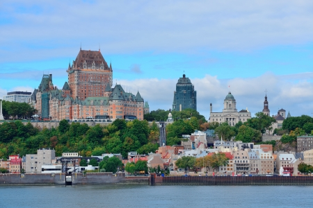 the famous: Quebec City skyline over river with blue sky and cloud.