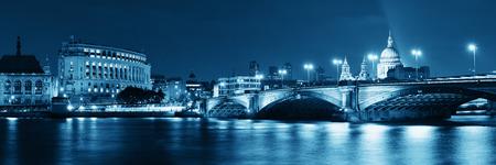 Blackfriars Bridge and St Pauls Cathedral in London at night. photo