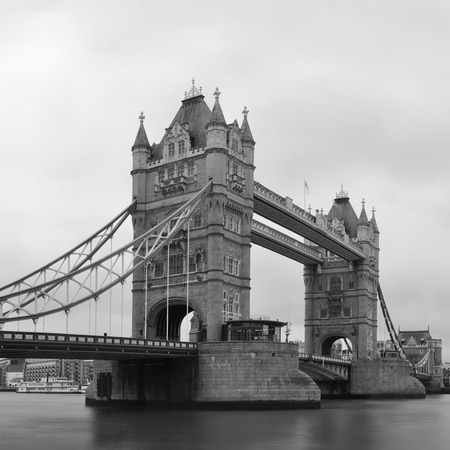 Tower Bridge black and white in London over Thames River as the famous landmark