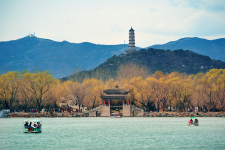 historical architecture: Summer Palace with historical architecture and boat in Beijing. Stock Photo