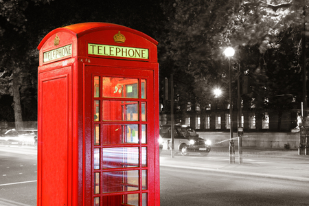 red telephone: Red Telephone Booth in street at night in London. Editorial