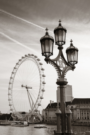 london eye: Vintage lamp post on Westminster Bridge in London..
