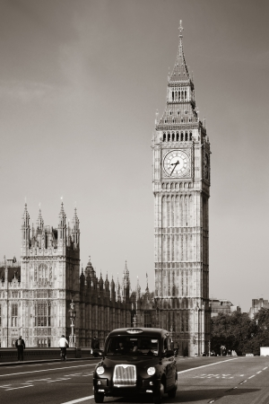 Vintage taxi on Westminster Bridge with Big Ben in London. Black and white photo